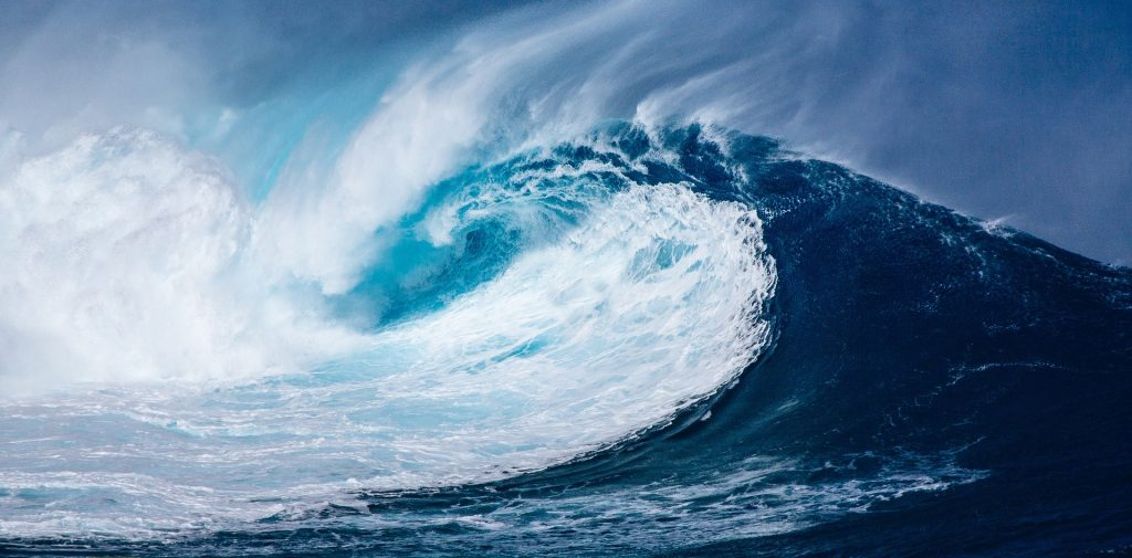 How do waves and tsunamis form?
